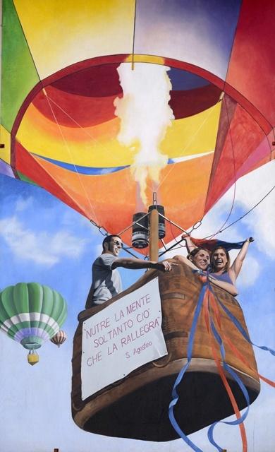 Aforismi volti a innalzare gli spiriti dei dairaghesi, così come la mongolfiera sale, in questo dipinto in cui si cita Sant'Agostino 'Nutre la mente soltanto ciò che la rallegra' (2009).