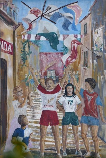 Murale che rappresenta i colori delle quattro contrade sfidanti al Palio di Dairago, manifestazione ludica e culturale di identità popolare la cui prima edizione risale al 1981.