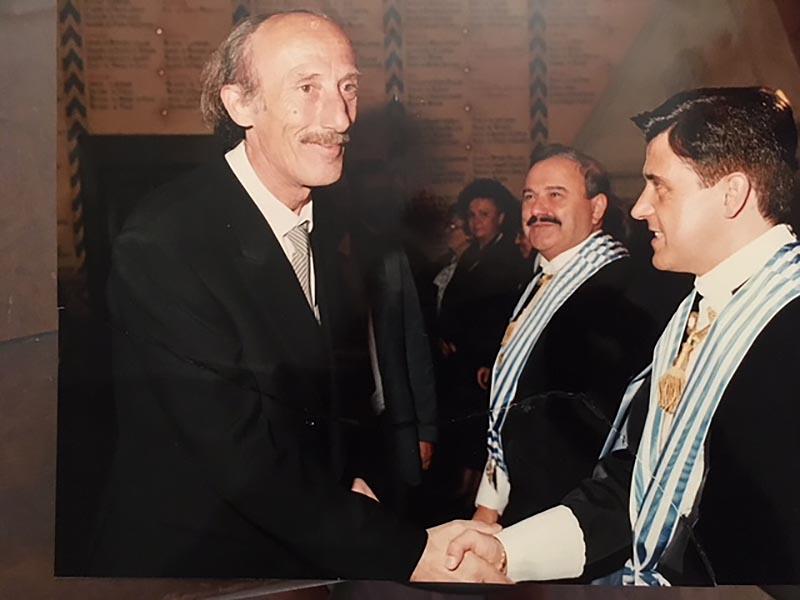 Gianni Giannini a San Marino: al centro il capitano reggente Gianluigi Berti